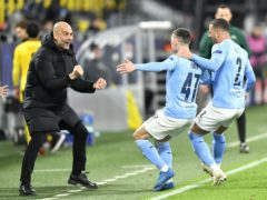 Manchester City manager Pep Guardiola celebrates with goal scorer Phil Foden and Kyle Walker, right (PA Wire via DPA)