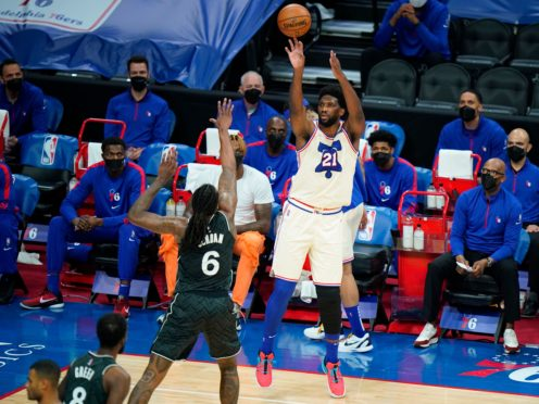 Philadelphia 76ers' Joel Embiid, right, goes up for a shot against Brooklyn Nets' DeAndre Jordan in their NBA clash (Matt Slocum/AP)