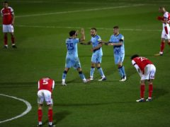 Coventry's Matty James, Liam Kelly and Kyle McFadzean, left-right, celebrate after beating Rotherham (Tim Goode/PA)
