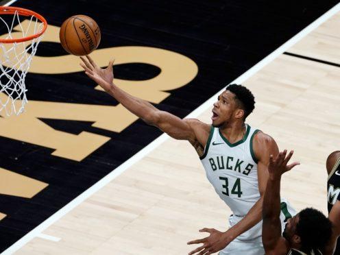 Milwaukee Bucks forward Giannis Antetokounmpo shoots in the first half of the NBA game against the Atlanta Hawks (John Bazemore/AP)