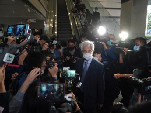 Pro-democracy activist Martin Lee, centre, arrives at a court in Hong Kong (Kin Cheung/AP)