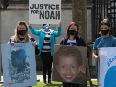 Supporters gather outside Laganside Courts in Belfast ahead of a pre-inquest review hearing for 14-year-old Noah Donohoe, who was found dead in a storm drain in north Belfast in June 2020. Picture date: Friday April 16, 2021.