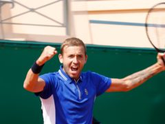 Dan Evans celebrates beating David Goffin (Jean-Francois Badias/AP)