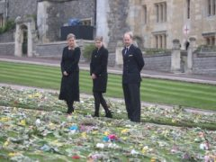 The Countess of Wessex, Lady Louise Windsor and the Earl of Wessex view flowers outside St George's Chapel, at Windsor Castle, Berkshire (Steve Parsons/PA)