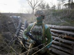 A Ukrainian soldier is seen at fighting positions on the line of separation from pro-Russian rebels near Luhansk, Ukraine, Friday, April 16, 2021. Growing cease-fire violations and a massive Russian military buildup near the Ukrainian border are causing tensions to rise in the conflict in eastern Ukraine, where more than 14,000 people have died in seven years of fighting between forces from Kyiv and separatists loyal to Moscow.(AP Photo/Efrem Lukatsky)