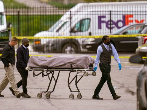 A body is taken from the scene (Michael Conroy/AP)