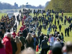People gather on the Long Walk as the King's Troop Royal Horse Artillery make their way towards Windsor Castle (Andrew Matthews/PA)