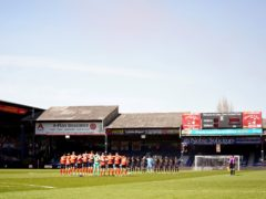Luton Town and Watford players stand for a minute's silence in memory of the Duke of Edinburgh (Tess Derry/PA)
