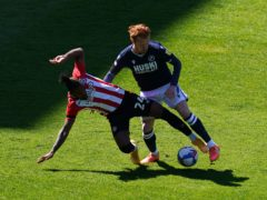 Ryan Woods, right, and Brentford's Tariqe Fosu (John Walton/PA)