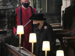 The Queen takes her seat in St George's Chapel, at Windsor Castle, Berkshire, for the funeral of the Duke of Edinburgh (Yui Mok/PA)