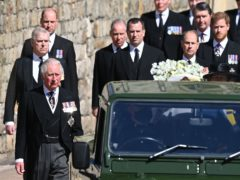 The Land Rover Defender carrying the coffin of the Duke of Edinburgh is followed by members of the royal family (Leon Neal/PA)