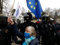 A woman waves a European Union flag in front of the Russian embassy in Prague, Czech Republic (Petr David Josek/AP)
