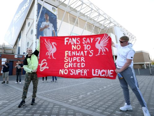 Fans protest outside the Leeds stadium against Liverpool's decision to join a proposed new European Super League ahead of the clubs' Premier League fixture (Zac Goodwin/PA)