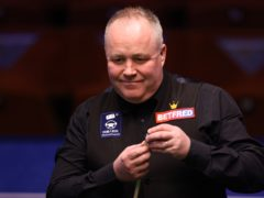 John Higgins battled to victory over Tian Pengfei (George Wood/PA)