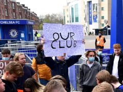 Fans protest against Chelsea's involvement in the new European Super League outside Stamford Bridge (Ian West/PA)
