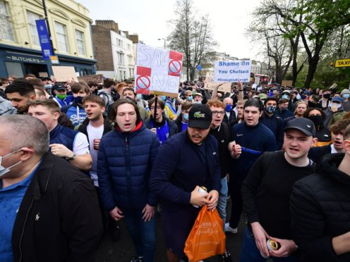 Chelsea fans protest against the Super League ahead of their match against Brighton on Tuesday (PA)