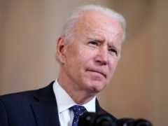 Joe Biden is announcing the updated US target at a summit he has convened (Evan Vucci/AP)