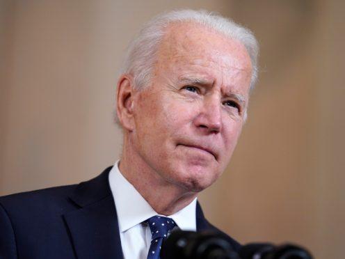 Joe Biden is announcing the updated US target at a summit he has convened (Evan Vucci/AP)