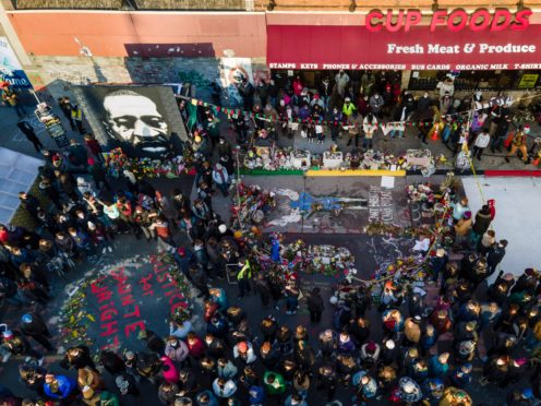 A crowd gathers at George Floyd Square after a guilty verdict was announced at the trial of former Minneapolis police Officer Derek Chauvin (Julio Cortez/AP)