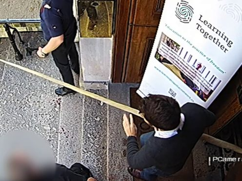 A screengrab which has been shown to the jury at the Fishmongers' Hall inquests, showing Darryn Frost carrying a narwhal tusk (Metropolitan Police/PA)