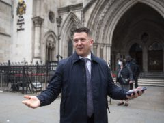 Tommy Robinson outside the Royal Courts of Justice (Victoria Jones/PA)