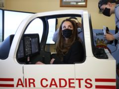 The Duchess of Cambridge sits in a flight simulator (Ian Vogler/Daily Mirror/PA)