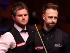 Judd Trump saw off Liam Highfield to reach round two at the Crucible (George Wood/PA)