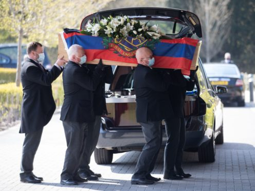 Pallbearers carry the coffin of D-Day veteran Albert Lilly into the chapel at the Oaks Havant Crematorium in Hampshire, for his funeral service. Picture date: Wednesday April 21, 2021.
