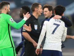 Hugo Lloris. left, says Ryan Mason is already equipped to be a manager (Adam Davy/PA)