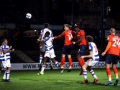 Luton's Glen Rea heads at goal during the draw with Reading (Tim Goode/PA)