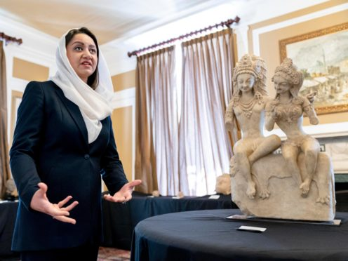 Afghan ambassador to the US Roya Rahmani at the Afghanistan embassy in Washington with looted and stolen Afghan religious relics and antiquities recovered by US government authorities (Andrew Harnik/AP)