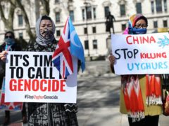 A demonstration in Parliament Square ahead of a House of Commons debate (Yui MokPA)