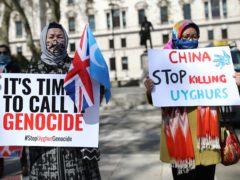 Uyghurs during a demonstration in Parliament Square (Yui Mok/PA)