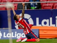 Angel Correa helped Atletico Madrid back to the top of LaLiga (Manu Fernandez/AP)