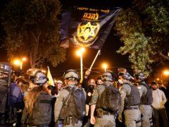 Israeli border police block members of Lahava, a Jewish extremist group (AP)