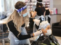 Lorraine Calvert gets her hair done by Laura Stevenson at Natural Hair Company, Lisburn (Peter Morrison/PA)