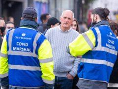 Covid marshals speak to members of the public in Soho, central London (Dominic Lipinski/PA)