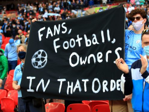 Manchester City fans hold up a banner at the Carabao Cup final at Wembley on April 25 (Adam Davy/PA)