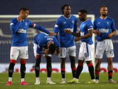 James Tavernier, left, and his despondent Rangers team-mates (Andrew Milligan/PA)