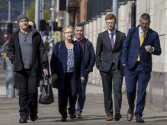 Joe McCann's widow Anne (centre) and family, with their solicitor, Niall Murphy (right), arriving at Laganside Court in Belfast (Liam McBurney/PA)