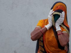 A relative of a patient who died of Covid-19 mourns outside a hospital in Ahmedabad (AP)