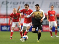 Ben Purrington (left) and Crewe striker Owen Dale battle for the ball (Adam Davy/PA)