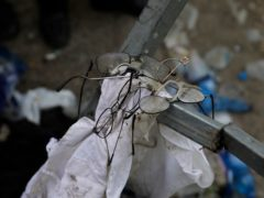 Broken glasses are seen at the site where fatalities were reported during Lag BaOmer festival at Mt. Meron in northern Israel, Friday, April 30, 2021. A stampede at the religious festival attended by tens of thousands of ultra-Orthodox Jews in northern Israel killed dozens of people and injured more than 100 others early Friday, medical officials said, in one of the country's deadliest civilian disasters. (AP Photo/Sebastian Scheiner)