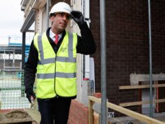 Chancellor Rishi Sunak wears a safety helmet on a construction site during a local election campaign visit in Hartlepool (Lee Smith/PA)