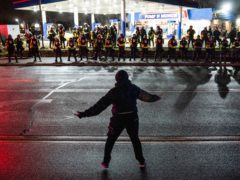 A demonstrator heckles authorities in Minneapolis (AP)