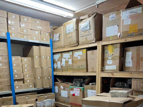 One of the hauls of fake designer goods found in Manchester (City of London Police/PA)