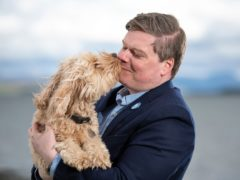 Chris McEleny and his dog Poppy launched Alba's animal welfare manifesto (Colin Fisher/PA)
