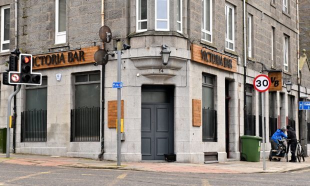Woman denies breaching Covid rules by allowing patrons inside Aberdeen pub to drink