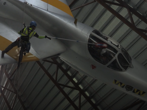A worker cleans one of the planes (PA)