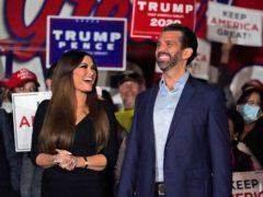 Donald Trump Jr with his girlfriend Kimberly Guilfoyle (John Bazemore/AP)